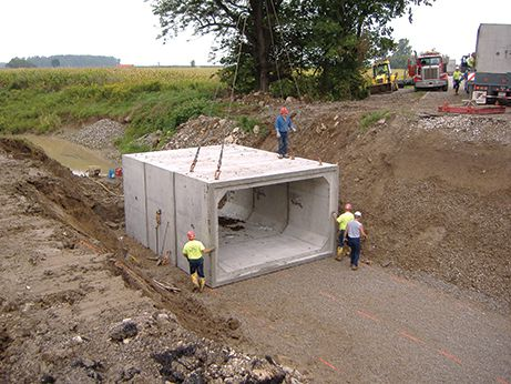 Concrete box culvert lowered into position